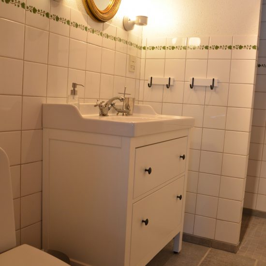 badrum-guldspegel